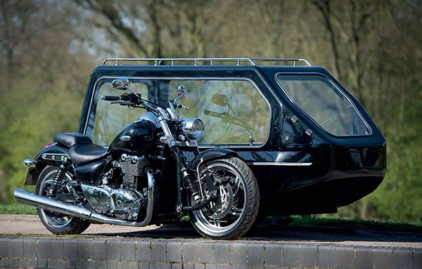triumph motorbike with hearse sidecar